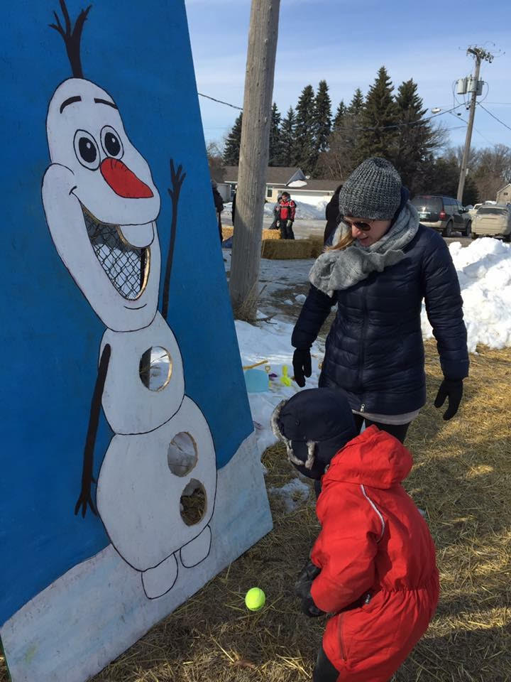 A child tries to get the ball into an Olaf the Snowman game board