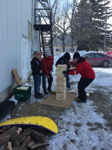 A few people try their hand at giant Jenga